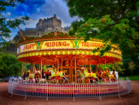 Carousel in front of a castle in Edinburgh